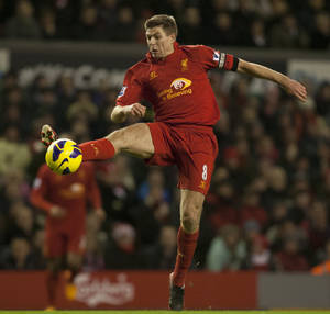 photo - Liverpool's Steven Gerrard controls a ball as his team lose 2-0 to West Bromwich Albion during their English Premier League soccer match at Anfield Stadium, Liverpool, England, Monday Feb. 11, 2013. (AP Photo/Jon Super)