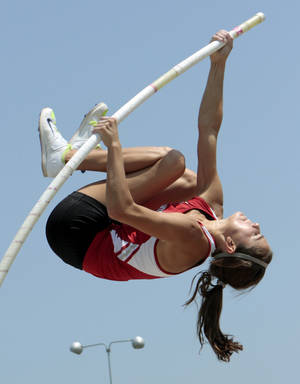 "Photo - Katie Whitekiller, Purcell junior, clears 12' 3"" for the win and a new state record height at the 3A and 4A state championship track meet on Saturday, May 5, 2012, in Ardmore, Okla.  Photo by Steve Sisney, The Oklahoman"