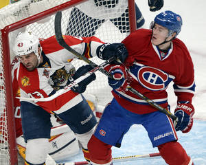 Photo - Montreal Canadiens right wing Brendan Gallagher (11) and Florida Panthers defenseman Mike Weaver (43) battle in front of the net during first-period NHL hockey action on Sunday, Dec. 15, 2013, in Montreal. (AP Photo/The Canadian Press, Ryan Remiorz)