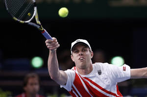 Photo -   Sam Querrey of the U.S returns the ball to Novak Djokovic of Serbia during their match at the Paris Tennis Masters tournament, Wednesday, Oct. 31, 2012. (AP Photo/Christophe Ena)