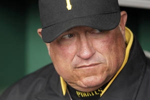 Photo -   Pittsburgh Pirates manager Clint Hurdle sits in the dugout during a 5-1 loss to the St. Louis Cardinals in a baseball game in Pittsburgh on Sunday, April 22, 2012. (AP Photo/Gene J. Puskar)