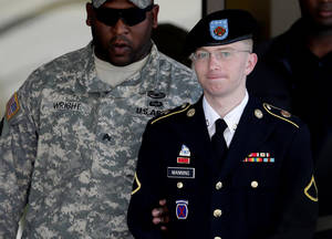 Photo -   FILE - In this June 25, 2012 file photo, Army Pfc. Bradley Manning, right, is escorted out of a courthouse in Fort Meade, Md. Lawyers for Julian Assange argue before the U.S. military's highest court for public access to legal documents in the court-martial of Pfc. Bradley Manning, the soldier charged with aiding the enemy for allegedly giving hundreds of thousands of classified U.S. documents to Assange's secret-busting website WikiLeaks. (AP Photo/Patrick Semansky, File)
