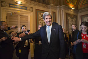 photo - Sen. John Kerry, D-Mass., emerges after a unanimous vote by the Senate Foreign Relations Committee approving him to become America's next top diplomat, replacing Secretary of State Hillary Rodham Clinton, on Capitol Hill in Washington, Tuesday, Jan. 29, 2013. Kerry, who has served on the Foreign Relations panel for 28 years and led the committee for the past four, is expected to be swiftly confirmed by the whole Senate later Tuesday.   (AP Photo/J. Scott Applewhite)