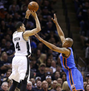 Photo - San Antonio's Danny Green (4) shoots over Oklahoma City's Caron Butler (2) during Game 1 of the Western Conference Finals in the NBA playoffs between the Oklahoma City Thunder and the San Antonio Spurs at the AT&T Center in San Antonio, Monday, May 19, 2014. Photo by Sarah Phipps, The Oklahoman