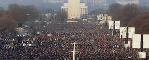 photo - FILE - This Jan. 20, 2009, file photo shows the crowd on the National Mall in Washington for the swearing-in ceremony of President-elect Barack Obama. Four years and one re-election after Obama became America's first black president, some of the thrill is gone. Yes, the inauguration of a U.S. president is still a big deal. But the ceremony that Washington will stage in a few weeks won't be the heady, historic affair it was in 2009, when nearly 2 million people flocked to the National Mall to see Obama take the oath of office. This time, District of Columbia officials expect between 600,000 and 800,000 people for Obama's public swearing-in on the steps of the Capitol on Monday, Jan. 21.  (AP Photo/Ron Edmonds, File)