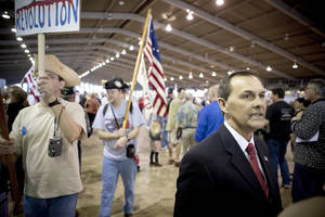 Photo - Gubernatorial candidate Randy Brogdon speaks to supporters during the Tea Party Express rally April 2 at the QuikTrip Center in Tulsa.  AP Photo
