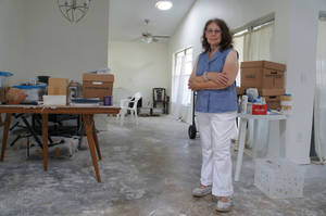 Photo - Linda Lipofsky, of Orlando, stands in the home that hurricanes destroyed in 2004. After eight grueling years, during which time a contractor ran off with the insurance money before finishing the job, she is moving back in thanks to the heroic efforts of Rebuilding Together. Photo courtesy of Rebuilding Together.  <strong></strong>