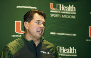 Photo - Miami coach Al Golden talks during an NCAA college football new conference, Monday, Jan. 6, 2014, in Miami. He said that he has been pursued by other programs, doing so while reaffirming his commitment to the Hurricanes and refusing to discuss his reported candidacy at Penn State. Golden played under Joe Paterno for the Nittany Lions and served as a team captain. (AP Photo/J Pat Carter)