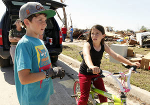 McClain Rogers and friend Emilee Rogers (no relation) talk about their good friend Sydney Angle in front of her home in the tornado devastated part of Moore, OK, Thursday, May 23, 2013. Sydney was killed by the tornado.  Photo by Paul Hellstern, The Oklahoman <strong>PAUL HELLSTERN - Oklahoman</strong>