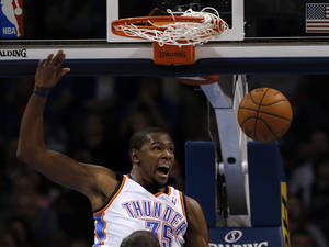 Photo - Oklahoma City's Kevin Durant reacts after a dunk during Sunday's game at Chesapeake Energy Arena.  Photo by Sarah Phipps, The Oklahoman