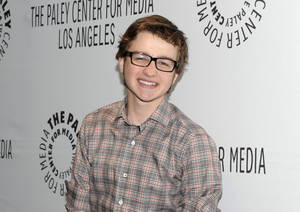 "Photo -   FILE - In this March 12, 2012 file photo, actor Angus T. Jones arrives at the Paleyfest panel discussion of the television series ""Two and a Half Men"" in Beverly Hills, Calif. Jones, the teenage actor who plays the half in the hit CBS comedy ""Two and a Half Men"" says it's ""filth"" and through a video posted by a Christian church has urged viewers not to watch it. (AP Photo/Dan Steinberg, File)"