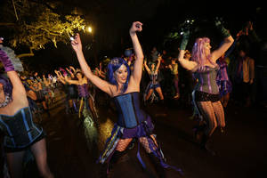 "Photo - Members of the Mardi Gras dance group ""The Sirens"" perform during the Krewe of Orpheus Mardi Gras parade in New Orleans, Monday, Feb. 11, 2013. (AP Photo/Gerald Herbert)"