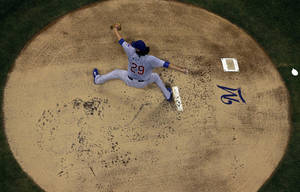 Photo - Chicago Cubs starting pitcher Jeff Samardzija throws during the first inning of a baseball game against the Milwaukee Brewers, Tuesday, Sept. 17, 2013, in Milwaukee. (AP Photo/Morry Gash)