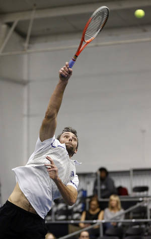 Photo - Ivo Karlovic, of Croatia, serves to Lu Yen-hsun, of Taiwan, in the semifinals at the U.S. National Indoor Tennis Championships on Saturday, Feb. 15, 2014, in Memphis, Tenn. Karlovic won the first set 6-1, and the match after Lu retired due to injury. (AP Photo/Rogelio V. Solis)