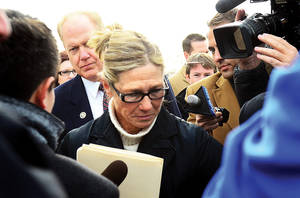 photo -   Rita Crundwell walks pass the media outside of the federal courthouse in Rockford, Ill. on Wednesday, Nov. 14, 2012. Crundwell, the former comptroller of Dixon, pleaded guilty to allegations she embezzled more than $50 million from the small city in Illinois to fund a lavish lifestyle that included a nationally known horse-breeding operation. She pleaded guilty to a charge of wire fraud and will remain free until her Feb. 14 sentencing hearing. (AP Photo/The Telegraph, Alex T. Paschal )