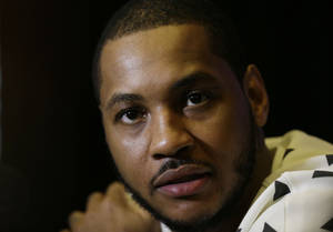 Photo - New York Knicks player Carmelo Anthony speaks during the NBA All Star basketball news conference, Friday, Feb. 14, 2014, in New Orleans. The 63rd annual NBA All Star game will be played Sunday in New Orleans. (AP Photo/Gerald Herbert)