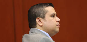 Photo - George Zimmerman listens to a prospective juror in Seminole circuit court during his trial, in Sanford, Fla., Wednesday, June 12, 2013. Zimmerman has been charged with second-degree murder for the 2012 shooting death of Trayvon Martin.(AP Photo/Orlando Sentinel, Joe Burbank, Pool)