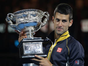 photo - Serbia's Novak Djokovic holds his trophy after defeating Britain's Andy Murray in the men's final at the Australian Open tennis championship in Melbourne, Australia, Sunday, Jan. 27, 2013. (AP Photo/Dita Alangkara)
