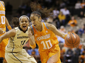 Photo - Tennessee guard Meighan Simmons (10) drives against Vanderbilt guard Jasmine Lister (11) in the first half of an NCAA basketball game on Thursday, Jan. 24, 2013, in Nashville, Tenn. (AP Photo/Mark Humphrey)