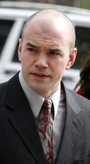 photo -   FILE - This Feb. 28, 2011 file photo shows Tim DeChristopher outside Frank E. Moss Federal Courthouse in Salt Lake City. A federal appeals court has upheld U.S. Interior Secretary Ken Salazar&#039;s decision to suspend 77 oil and gas parcels sold in Utah in the final year of the Bush administration. The Denver-based U.S. 10th Circuit Court of Appeals said bidders missed a 90-day deadline to file a lawsuit against the federal government. It was the same auction where a Utah environmental activist jumped into the bidding to protest the sales and safeguard parcels around national parks.Tim DeChristopher is now serving two years in federal prison for disrupting the December 2008 auction in Salt Lake City. (AP Photo/Jim Urquhart, File)  