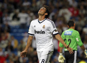 Photo -   Real Madrid's Kaka from Brazil, left, celebrates his goal during a Santiago Bernabeu Trophy soccer match against Millonarios at the Santiago Bernabeu stadium in Madrid, Spain, Wednesday, Sept. 26, 2012. (AP Photo/Andres Kudacki)