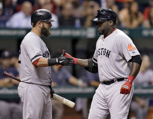 Photo - Boston Red Sox's David Ortiz, right, celebrates with on-deck batter Mike Napoli after his sixth-inning home run off Tampa Bay Rays starting pitcher Jeremy Hellickson during a baseball game Thursday, Sept. 12, 2013, in St. Petersburg, Fla. (AP Photo/Chris O'Meara)