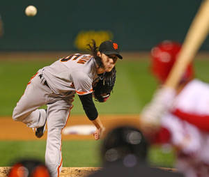 Photo -   San Francisco Giants starting pitcher Tim Lincecum throws during the first inning of Game 4 of baseball's National League championship series against the St. Louis Cardinals Thursday, Oct. 18, 2012, in St. Louis. (AP Photo/Dilip Vishwanat, Pool)