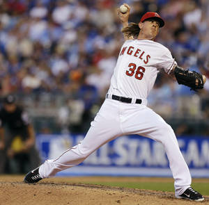 Photo -   American League's Jered Weaver, of the Los Angeles Angels, delivers against the National League during the fifth inning of the MLB All-Star baseball game, Tuesday, July 10, 2012, in Kansas City, Mo. (AP Photo/Jeff Roberson)
