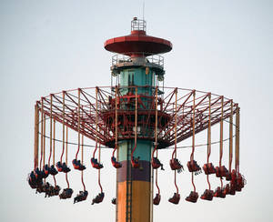 photo -   People on the Windseeker ride at Knott's Berry Farm are stuck a few hundred feet off the ground Wednesday, Sept. 19, 2012, in Buena Park, Calif. The ride held about 20 people in suspended above ground as the park's ride maintenance crews worked to get the passengers down_the riders were brought down a couple hours later and the park closed. (AP Photo/The Orange County Register, Rod Veal) MAGS OUT; LOS ANGELES TIMES OUT