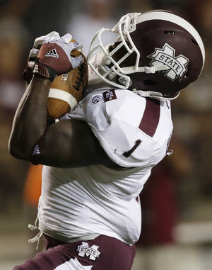 Photo -   Mississippi State wide receiver Chad Bumphis (1) catches a touchdown pass in the first half of a NCAA college football game against Troy in Troy, Ala., Saturday, Sept. 15, 2012. (AP Photo/Dave Martin)