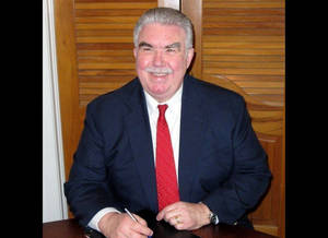 Photo - This undated photo taken from the Kaufman County, Texas, website shows Kaufman County District Attorney Mike McLelland. McLelland and his wife were found killed in their house, Saturday, March 30, 2013, two months after one of his assistants was gunned down near their office, authorities said. (AP Photo/Kaufman County)