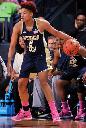 Photo - Georgia Tech guard Aaliyah Whiteside drives the lane in the second half of an NCAA college basketball game against Notre Dame, Monday, Feb. 17, 2014, in South Bend, Ind. Notre Dame won 87-72 with Whiteside scoring 21 points. (AP Photo/Joe Raymond)