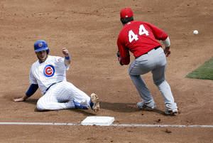 Photo - Los Angeles Angels' Ian Stewart (44) makes the catch as Chicago Cubs' Mike Olt advances safely to third base on a hit by teammate Darwin Barney during the second inning of a spring training baseball game, Tuesday, March 25, 2014, in Mesa, Ariz. (AP Photo/Matt York)