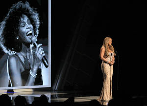 Photo -   Mariah Carey speaks during the in memoriam to Whitney Houston at the BET Awards on Sunday, July 1, 2012, in Los Angeles. (Photo by Matt Sayles/Invision/AP)