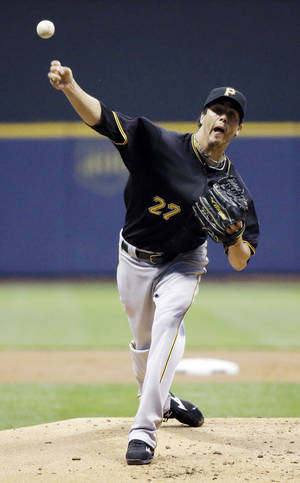 Photo -   Pittsburgh Pirates starting pitcher Jeff Karstens throws during the first inning of a baseball game against the Milwaukee Brewers Friday, Aug. 31, 2012, in Milwaukee. (AP Photo/Morry Gash)