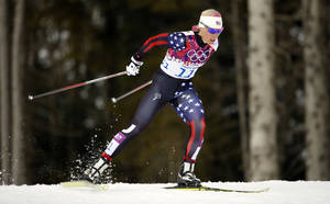Photo - United States' Kikkan Randall competes during the women's qualifications of the cross-country sprint at the 2014 Winter Olympics, Tuesday, Feb. 11, 2014, in Krasnaya Polyana, Russia. (AP Photo/Felipe Dana)