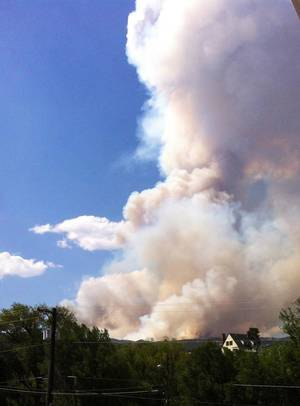 Photo - This photo, taken from our Manitou Springs, Colo., hotel room, shows how large the Waldo Canyon wildfire was a few hours after it began. <strong>DON MECOY - THE OKLAHOMAN</strong>
