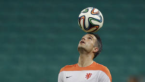 Photo - Netherlands' Robin van Persie controls the ball during an official training session the day before the group B World Cup soccer match between Spain and the Netherlands at the Arena Ponte Nova in Salvador, Brazil, Thursday, June 12, 2014.  (AP Photo/Natacha Pisarenko)