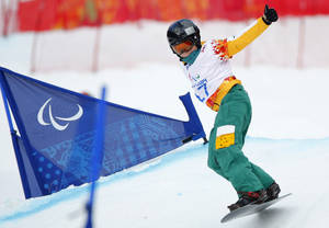 Photo - Ben Tudhope of Australia competes during the men's para-snowboard cross, standing event at the 2014 Winter Paralympic, Friday, March 14, 2014, in Krasnaya Polyana, Russia. (AP Photo/Dmitry Lovetsky)