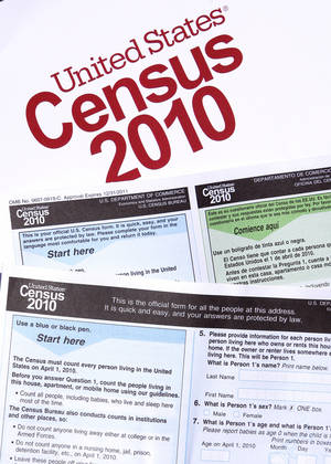 Photo - Copies of the 2010 census forms are seen during a March 15 news conference  in Phoenix. Officials say that everyone should have received a census form in the mail by now. AP PHOTO