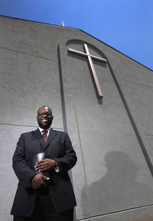 Photo - The Rev. Ray Douglas, senior pastor of Greater Mount Olive Baptist Church, stands outside the northeast Oklahoma City house of worship at 1020 NE 42.  <strong>Garett Fisbeck - Garett Fisbeck</strong>