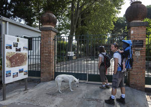 Photo - Visitors wait in front of one of Pompeii gates, Italy, Monday, June 23, 2014. A labor dispute kept tourists locked out of Pompeii for part of Monday, the latest in a spate of hours-long closures at the ancient Roman ruins. The gates were unlocked a couple of hours late, frustrating tourists wanting to enter the sprawling ruins in early morning. The dispute over work schedules and back pay began last week, keeping thousands of visitors shut out for hours at a time during union meetings. The government office that runs Pompeii said that three assemblies planned later this week were canceled, meaning visitors could expect regular opening hours. (AP Photo/Salvatore Laporta)