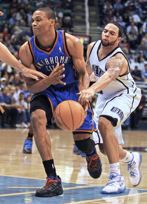 Photo - The Thunder's Russell Westbrook, left, has the ball knocked away by Utah's Deron Williams. AP photo