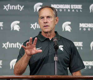 Photo - Michigan State coach Mark Dantonio addresses the media during the team's NCAA college football media day, Monday, Aug. 4, 2014, in East Lansing, Mich. (AP Photo/Al Goldis)