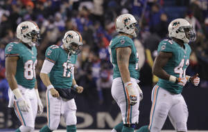 Photo -   Miami Dolphins quarterback Ryan Tannehill (17) leaves the field with teammates after throwing an interception to end the second half of an NFL football game against the Buffalo Bills Thursday, Nov. 15, 2012 in Orchard Park, N.Y. The Bills won the game 19-14. (AP Photo/Bill Wippert)