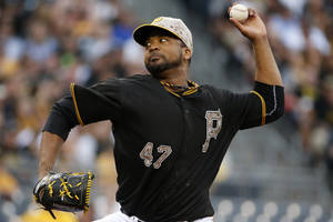 Photo - Pittsburgh Pirates' Francisco Liriano (47) delivers during the first inning of a baseball game against the Chicago Cubs in Pittsburgh Tuesday, June 10, 2014. (AP Photo/Gene J. Puskar)