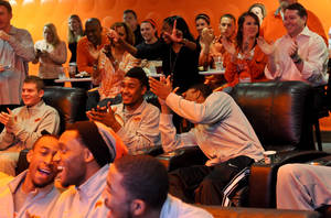 Photo - Members of the Oklahoma State basketball team celebrate their seeding in the NCAA tournament at a watch party held in the team locker room inside Gallagher Iba Arena in Stillwater, Okla., on March 17, 2013. KT King/For the Tulsa World