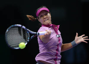 Photo - Li Na of China returns a shot to Jelena Jankovic of Serbia during their tennis match at the WTA championship in Istanbul, Turkey, Thursday, Oct. 24, 2013. The world's top female tennis players compete in the championships which runs from Oct. 22 until Oct. 27.(AP Photo)