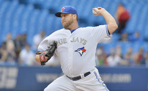 Photo - Toronto Blue Jays starting pitcher Mark Buehrle pitches to the Atlanta Braves during first inning interleague baseball action in Toronto on Monday, May 27, 2013. (AP Photo/The Canadian Press, Nathan Denette)