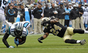 Photo -   Carolina Panthers' Brandon LaFell (11) is upended by New Orleans Saints' Corey White (24) during the second quarter of an NFL football game in Charlotte, N.C., Sunday, Sept. 16, 2012. (AP Photo/Rainier Ehrhardt)